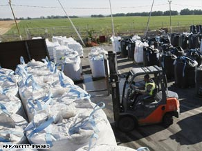 Israeli workers prepare humanitarian supplies to be delivered in Gaza on Tuesday.
