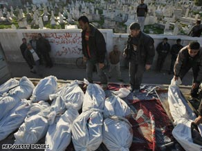 Palestinians prepare Tuesday to bury members of a family they said died in an Israeli airstrike in Gaza City.