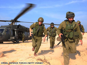 In a handout photo from Israel Defense Forces, troops deploy Tuesday in northern Gaza.