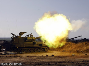 Israeli artillery fires a shell toward Gaza from the Israel-Gaza border on Wednesday.