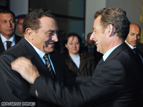 Egyptian President Hosni Mubarak, left, welcomes French President Nicholas Sarkozy in Egypt on Tuesday.
