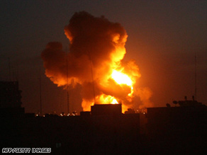 Flames rise into the sky after an Israeli airstrike Wednesday night in Rafa, on the Gaza-Egypt border.