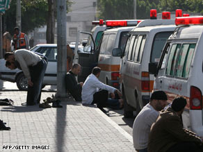 Ambulance drivers wait for Israel and the Red Cross to give them the green light Thursday to leave Gaza City.