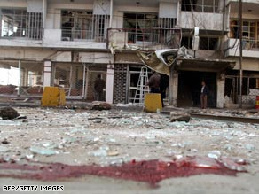 Blood stains the ground following the explosion of an IED on Kahramana Square in Baghdad on January 12.