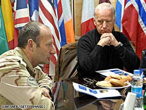 Vice President-elect Joe Biden, right, is briefed Sunday by  International Security Assistance Force Maj. Gen. Mart C. de Kruif in Kandahar, Afghanistan.