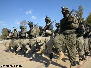 Iraqi soldiers parade in Kirkuk on January 10. The Pentagon credits better forces for improved security.