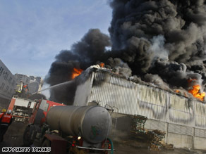 A warehouse at the U.N. compound was set ablaze during the fighting.