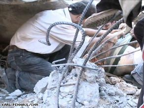 Men work to uncover bodies from the rubble of a Gaza home that witnesses say was destroyed in an Israeli attack.