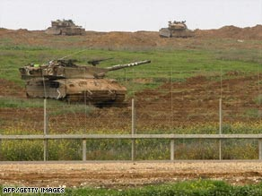 Israeli tanks prepare to leave Gaza on Monday.