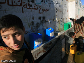 A family lives in a shelter at a U.N. school in Gaza City where about 50,000 people are living in U.N. shelters.