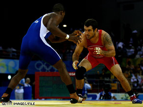 Andy Hrovat, right, seen wrestling Reineris Salas of Cuba, is among the U.S. wrestlers touring this winter.