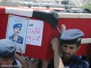 Yemeni soldiers carry the coffin of a comrade killed in September's attack on the U.S. Embassy.