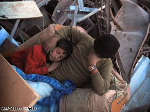 A family sleeps outside their destroyed house in Jabalia's Ezbet Abed Rabbo district in northern Gaza.