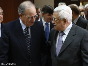George Mitchell (left) is welcomed by Mahmoud Abbas in the West Bank city of Ramallah.