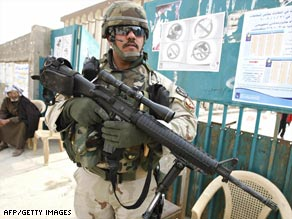 An Iraqi soldier guards a Baghdad polling station Friday in preparation for the upcoming provincial elections.