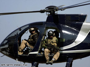 Blackwater guards fan out to secure the site of a Baghdad roadside bombing in 2005.