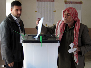 An Iraqi casts her ballot Saturday in Baghdad. About 4,000 women are running for office.