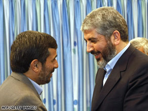 Hamas leader Khaled Meshaal, right, greets Iranian President Mahmoud Ahmadinejad on Sunday.