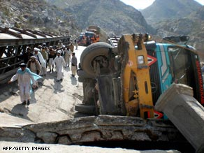 An overturned truck on the bridge in Khyber, Pakistan, destroyed by militants.