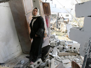 A woman looks over her destroyed home Saturday in Gaza after an Israeli airstrike the night before.
