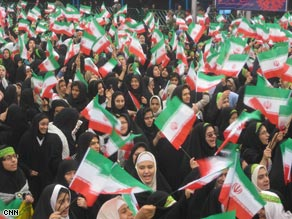 Crowds gathered under giant portraits of leaders including the Ayatollah Khomeini at the Tehran rally Tuesday.