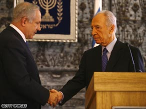Netanyahu (left) shakes hands with Peres, who has asked him to form the next Israeli government.