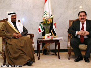 Kuwaiti Foreign Minister Sheikh Mohammed al-Sabah (left) is greeted by his Iraqi counterpart Hoshyar Zebari.
