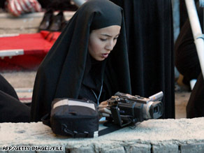 Authorities say journalist Roxana Saberi, shown working in Iran in 2004, has confessed to spying charges.