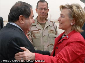 U.S. and Iraqi officials greet Secretary of State Hillary Clinton on her arrival Saturday in Baghdad.