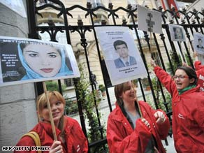 Reporters Without Borders members demonstrate on Sunday at the Iranian Embassy in Paris, France.