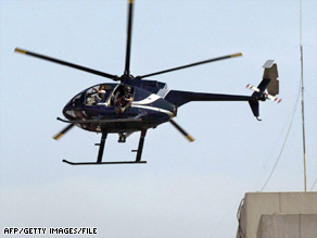 A helicopter for the private security firm then known as Blackwater flies over Baghdad in October 2003.