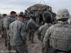 U.S. Army troops get a safety briefing before departing Camp Liberty, Iraq, in December 2008.