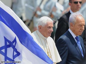 Pope Benedict XVI on the banks of the river Jordan on his first visit to the Middle East.