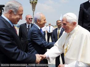 Israeli Prime Minister Benjamin Netanyahu greets Pope Benedict XVI on Monday in Tel Aviv.