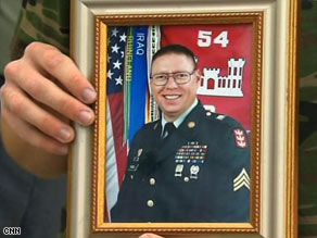 The Camp Liberty shooter has been identified as Army Sgt. John M. Russell of Sherman, Texas.