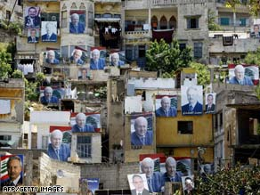 Election posters hang on the exterior of many buildings in Tripoli, Lebanon, last week.