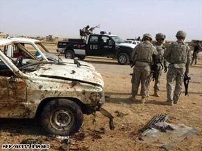 U.S. soldiers examine the scene of a bombing Thursday in Kirkuk, Iraq, that killed eight Sons of Iraq members.