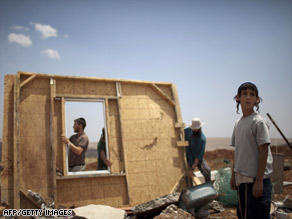 Israeli settlers look at the remains of an illegal outpost on the West Bank, taken down by security forces on Thursday.