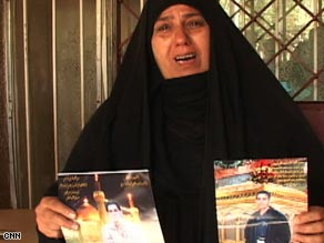 Raed's mother holds worn-out photographs of her murdered son.