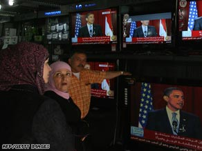 Palestinians in East Jerusalam watch President Obama&#039;s speech at an electronics shop.