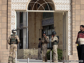 Iraqi security forces stand guard outside a Baghdad mosque following the attack on a prominent lawmaker.