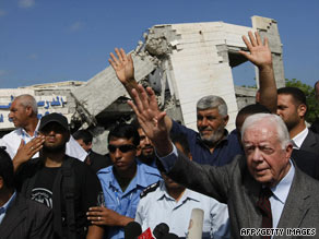 Former President Jimmy Carter visits an American school in Gaza destroyed by Israeli bombings.