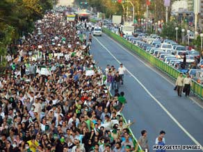 Supporters of defeated reformist candidate Mir Hossein Moussavi line the streets of Tehran Wednesday.