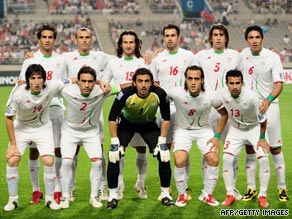 Members of Iran's National Soccer Team sport green bands in their game against South Korea on Wednesday.