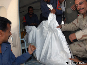Yemeni military and medical staff remove the body of one of the hostages.