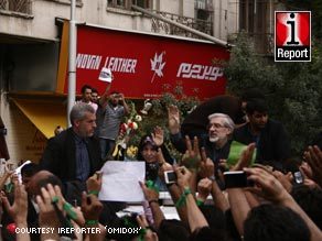 Mir Hossein Moussavi (right, in green sash) greets supporters at Thursday's rally.