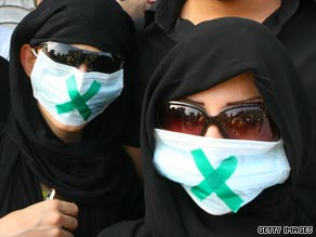Iranian women demonstrate Thursday in the streets of Tehran, the capital city.