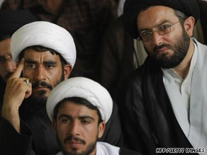 Iranian clerics listen to Grand Ayatollah Ali Akbar Khamenei at Tehran University earlier today
