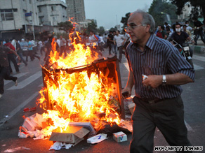 Protesters fight running battles with motorcycle-mounted militia members Saturday in Tehran.