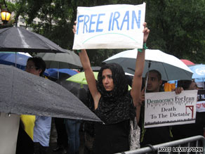 Iranian-Americans shout slogans against Mahmoud Ahmadinejad in front of the White House.